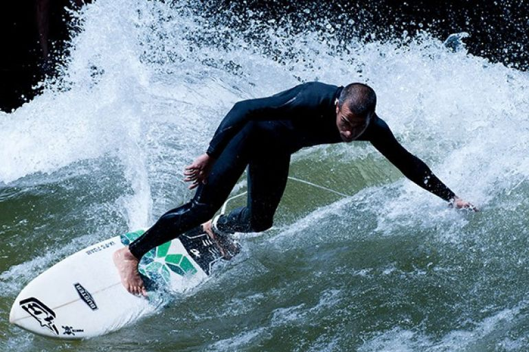 The Eisbach surfer phenomenon